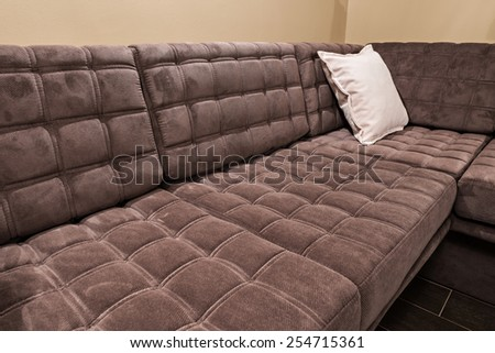 Modern corner sofa in home interior - stock photo