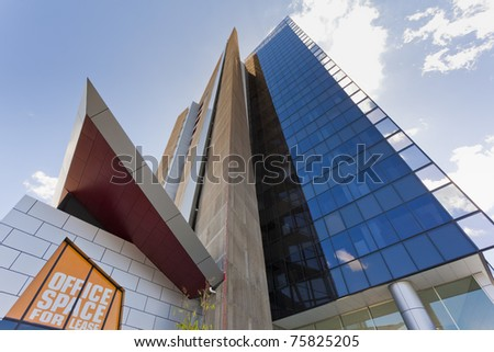 Modern Corporate Building shot from below in perspective - stock photo
