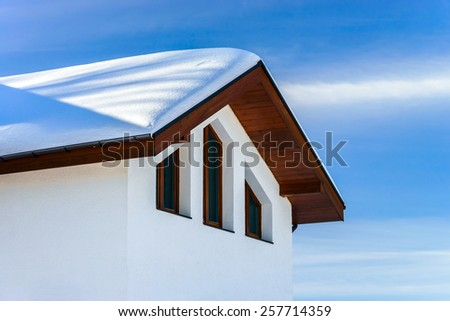 Modern country house, winter sunny day, snow and sun - stock photo
