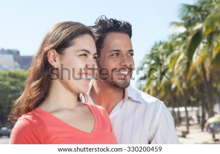 Modern couple in the city looking sideways - stock photo