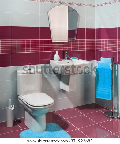 modern cozy bathroom with red and white tiles