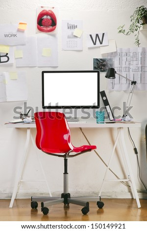 Modern creative workspace with computer and red chair. The office of a creative worker. - stock photo
