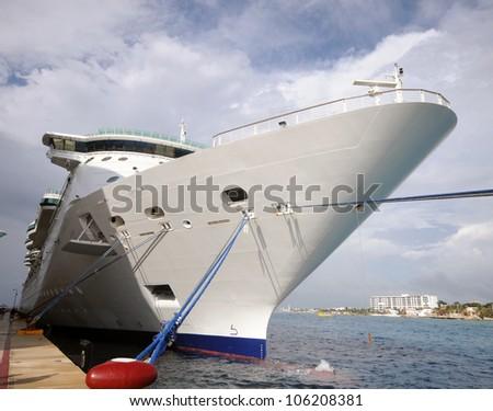 Modern cruise ship in port - stock photo