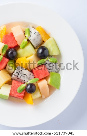Modern cuisine style fruits salad in ceramic dish