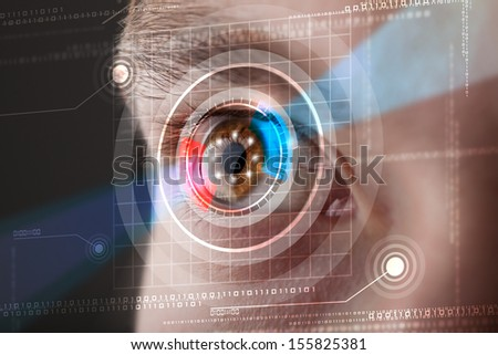 Modern cyber man with technology eye looking - stock photo