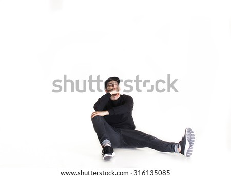 Modern dancer dancing at studio.hip hop dancer jumping high on a concrete background. The man is doing parkour or leaping. - stock photo