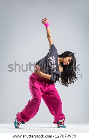 modern dancer poses in front of the studio background - stock photo