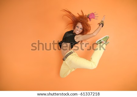 Modern dancer poses in front of the vivid background - stock photo