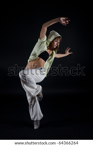 Modern dancer poses on black background