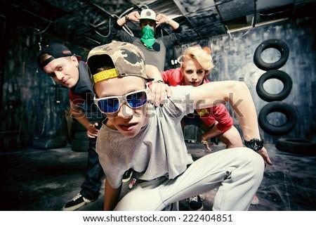 Modern dancers dancing in the garage. Urban lifestyle. Hip-hop generation. - stock photo