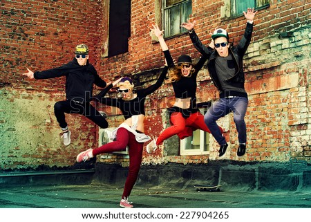 Modern dancers dancing on the street. Urban lifestyle. Hip-hop generation. - stock photo