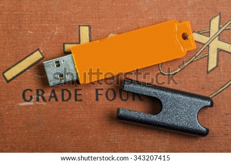 Modern Day Thumb Drive Versus an Older Math Book - stock photo