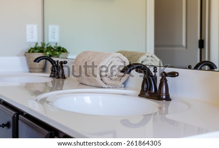 Modern, decorated bathroom in a nice home - stock photo