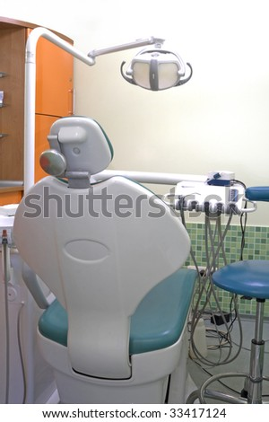 Modern dentist's chair in a medical room. HDR image.