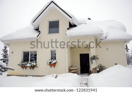 modern design home in winter covered with snow - stock photo