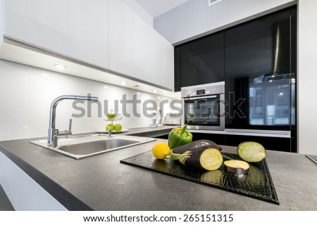 Modern design kitchen with electric appliances and stone worktop - stock photo
