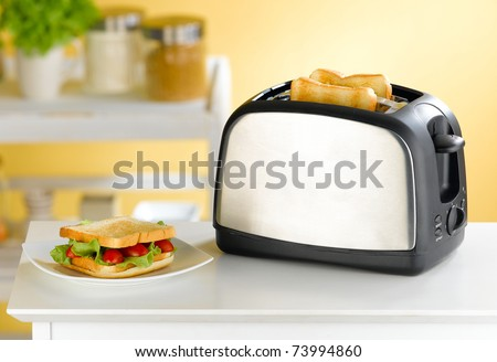 Modern design of the bread toaster in the kitchen interior - stock photo