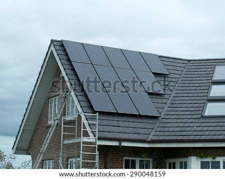 Modern design small solar panel for green, environmentally friendly energy - stock photo