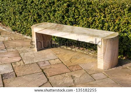 Modern design stone marble garden park bench - stock photo