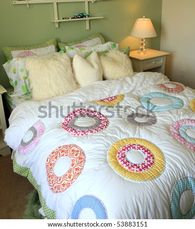 Modern designer bedroom with stylish furniture and decor. - stock photo