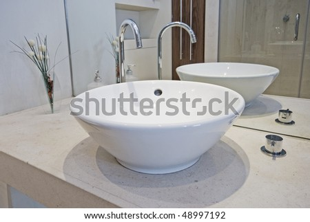 modern designer hand wash basin in a bowl shape - stock photo