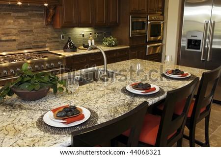 Modern designer kitchen with a granite island. - stock photo