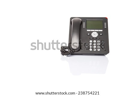 Modern desktop telephone over white background