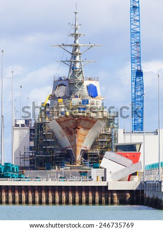Modern destroyer under construction in a naval shipyard - stock photo