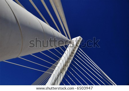 Modern details of bridge. Holding cables. - stock photo