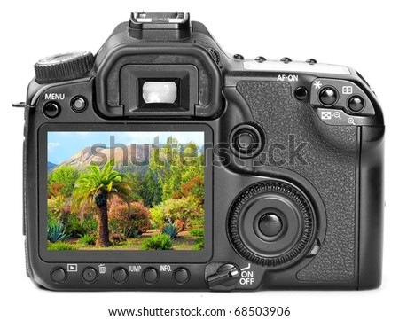 Modern digital camera back side with picture of a tropical paradise ( Lipari island - Italy) on  a display. - stock photo