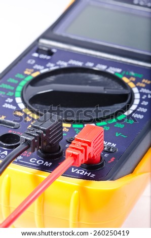 Modern digital multimeter on a white background, shallow depth of field - stock photo