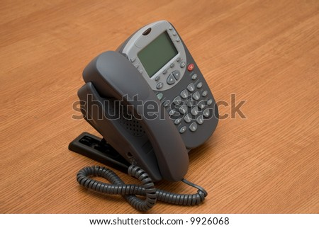 Modern digital phone on the table - stock photo