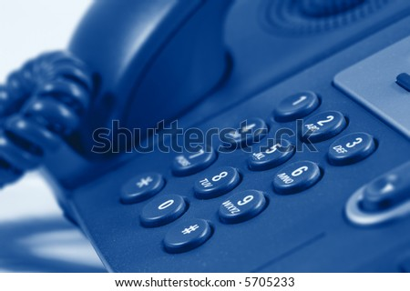 Modern Digital Phone. Very shallow depth of field. Focus on digits 0852. Visible texture of plastic. - stock photo