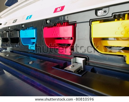 modern digital printing press, concept, closeup of the toner cartridges - stock photo