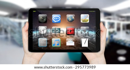 Modern digital tactile tablet on blured office background 'elements of this image funished by NASA' - stock photo