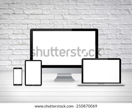 Modern digital tech device on wood background - stock photo