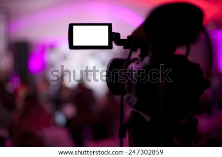 Modern Digital Video Camera on studio - stock photo