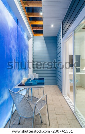 Modern dining room, balcony with a table and chairs in luxury house. - stock photo