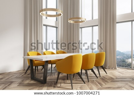 Modern dining room corner with white walls, a wooden floor and a whitte and black table with yellow chairs. A window. 3d rendering mock up