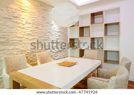 Modern dining room equipped with luxury furniture - stock photo