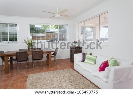 Modern dining room in Australian mansion - stock photo