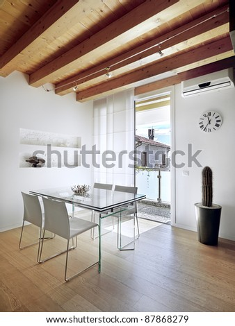 Modern Dining Room Overlooking On The Balcony With Wood Ceiling And Wooden Flooring