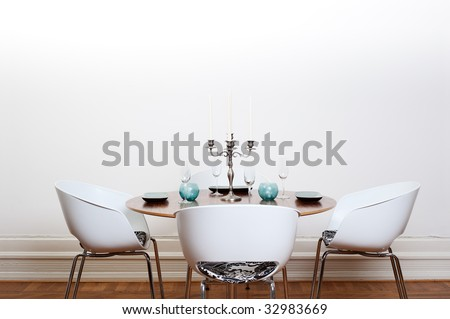 Modern dining room with a round table and  white chairs and background. - stock photo