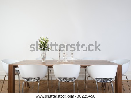 Modern dining room with big white wall - stock photo