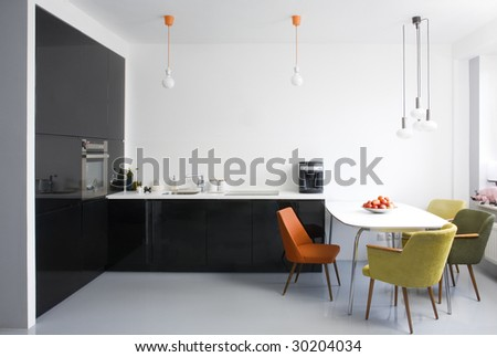 modern dining room with kitchen - stock photo