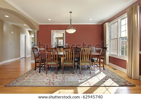 Modern dining room with salmon colored walls - stock photo