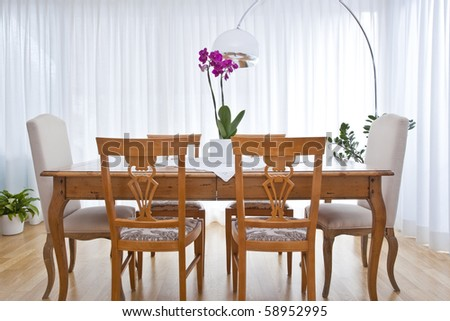 modern dining room with white curtains