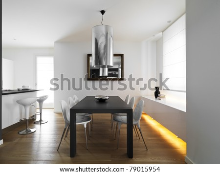 modern dining room with wood floor - stock photo