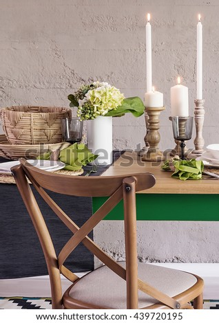 modern dining table and comfortable chairs in modern home with elegant table setting - stock photo