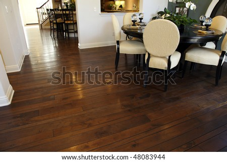 Modern dining table and hallway with hardwood flooring. - stock photo